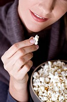 Close-up of a mid adult woman eating popcorn (thumbnail)
