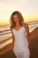 Woman on Beach at Sunset portrait