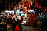 Veiled women talk at a market in the old city section of Jerusalem