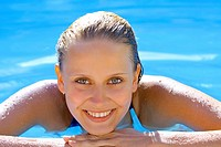 Woman refreshing in the swimming pool