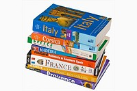 Cut Out, of Stacked Travel Guide Books