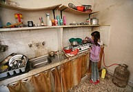 An Iraqi refugee girl prepares a meal for her family  Many Iraqi refugees have settled in Amman, Jordan because of the ongoing violence in their own c...