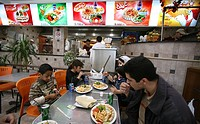 Iraqi refugees eat in a restaurant in Amman  Many Iraqi refugees have settled in Amman, Jordan because of the ongoing violence in their own country
