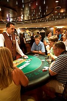 August 2008 - Cruise ship passengers playing Texas Holdem tournament in the casino of the Sovereign of the Seas while at sea in Bahamas