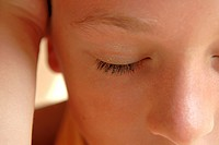 Close_up of a girl's face with her eyes closed