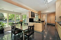 Kitchen in luxury home with windowed eating area