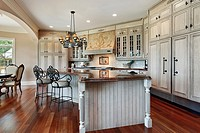 Kitchen in luxury home with curved island