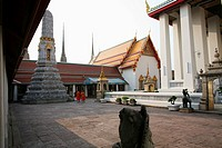 Two monks in a courtyard at the Grand Palace complex near Bangkok