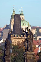 charles bridge, church spires in the distance, prague, czech republic