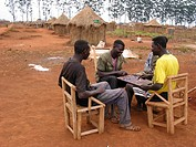 Men play a game in a village in Angola  Feeding centres and other humanitarian aid were organised in Angola after widescale malnutrition during and fo...