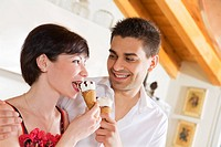 domestic life: happy couple eating an ice cream