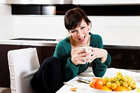 home life: woman drinking a cup of tea