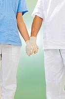 doctor and nurse holding hands in the hospital