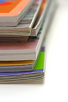 Close up of a stack of magazines on a white coffee table