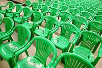 Many the green chairs placed by rows