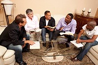 group of men studying the bible