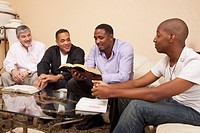 four men studying the bible
