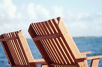 Wooden Chairs by the Ocean