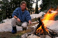 Woman Poking Campfire