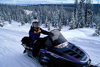 Woman Snowmobiling