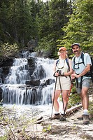 Couple hiking near a waterfall