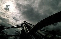 Industrial Structures Under A Dark Gray Sky