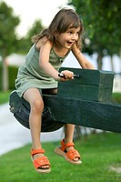 Laughing Caucasian Girl Riding A Seesaw