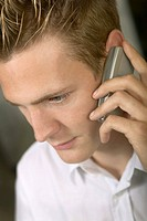 Young Caucasian Male Talking On A Cell Phone
