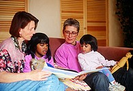 Lesbian parents read with E  Indian adopted daughters