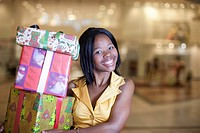 Woman holding Christmas gifts, KwaZulu Natal Province, South Africa