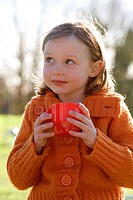 Close_up of a girl holding a coffee cup