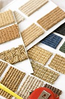 Close-up of swatches of carpeting displayed on sheets (thumbnail)