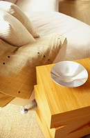 Close_up of a bed with side table