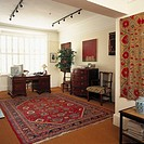 View of a study with tapestry on the walls
