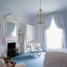 View of a blue and white nursery with a fireplace