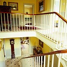 Hand railing along a flight of stairs inside a house