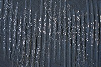Close_up of water flowing down a wall