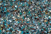 Close_up of a pile of shiny stones