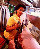 A woman ironing at a laundry service