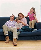 Family portrait on the couch (thumbnail)