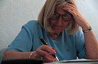 elderly woman making notes