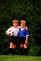Two boys posing in soccer uniforms (thumbnail)