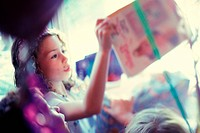 little girl opening a book