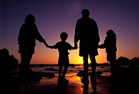 A family watching sunset at the beach