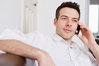 man sitting on sofa with mobile phone
