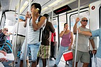 Florida, Miami, Metromover, public transportation, mass transit, automated people-mover, passenger, Black, woman, man, couple, standing, holding on, c...
