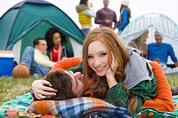Romantic couple camping and attending outdoor festival