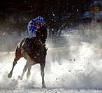 Horse racing on the frozen lake in Arosa, Graubunden, Switzerland.