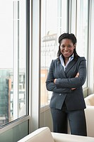 Black businesswoman standing by window