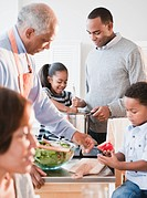 African American family cooking together